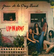 Juan De La Cruz Band: Up In Arms